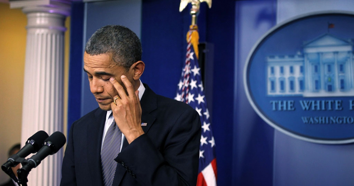 U.S. President Barack Obama wipes tears as he makes a statement at the White House in Washington, DC, in response to the Sandy Hook elementary school shooting in Newtown, Connecticut, on December 14, 2012.</p>