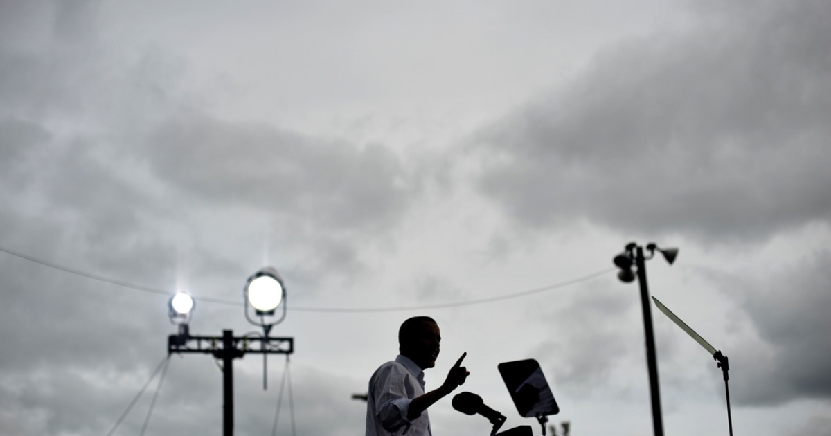 President Barack Obama speaks during Labor Day celebrations on September 5, 2011 outside GM's world headquarters in Detroit.</p>