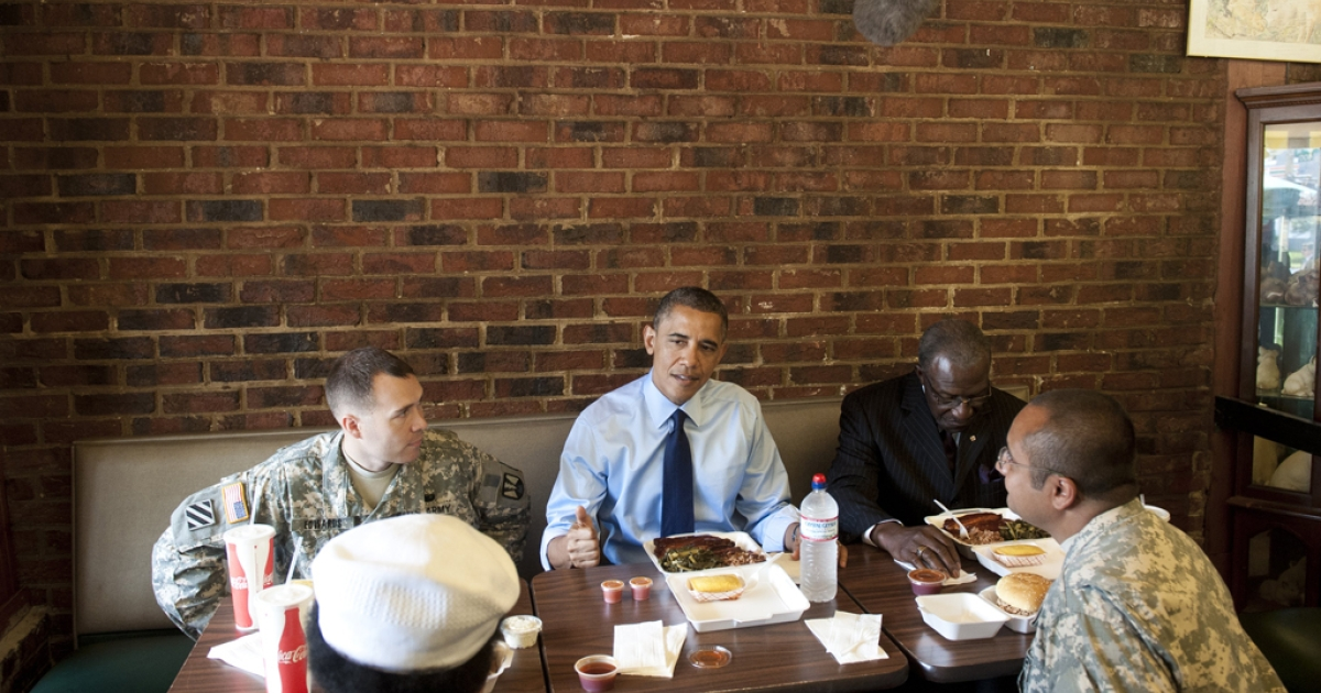 US President Barack Obama has lunch with two soldiers and two local barbers in honor of Fathers Day weekend at Kenny's BBQ Smokehouse in Washington, DC, on June 13, 2012.</p>