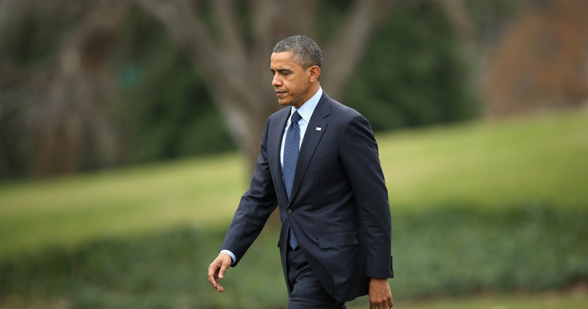 US President Barack Obama walks across the South Lawn of the White House before departing December 20, 2012 in Washington, DC.</p>