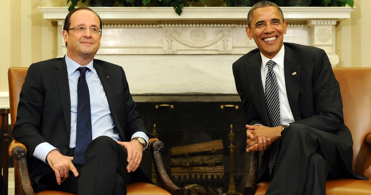 US President Barack Obama and French President Francois Hollande smile during a bilateral meeting in the Oval Office at the White House in Washington, DC, on May 18, 2012 in advance of the G8 and NATO Summits.</p>