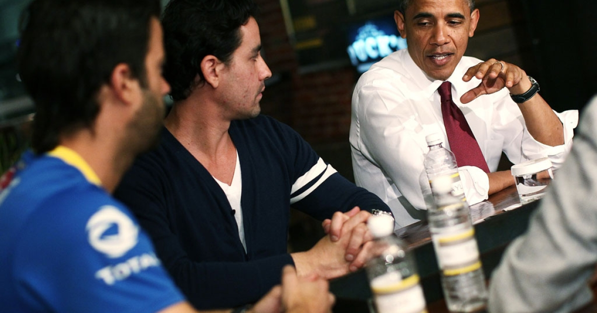 U.S. President Barack Obama speaks with David Mazza, left, and Casey Patten, co-owners of Taylor Gourmet, a sandwich shop in Washington on May 16, 2012. Obama is urging Congress to act on his