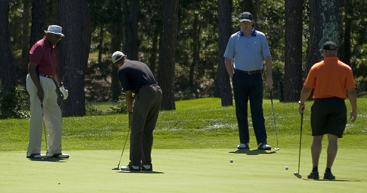 US President Barack Obama (2nd L) putts on the first green at Farm Neck Golf Course in Oak Bluffs, Massachusetts, August 23, 2011, with Vernon Jordan (L), White House Trip Director Marvin Nicholson (2nd R) and Eric Whitaker (R).</p>