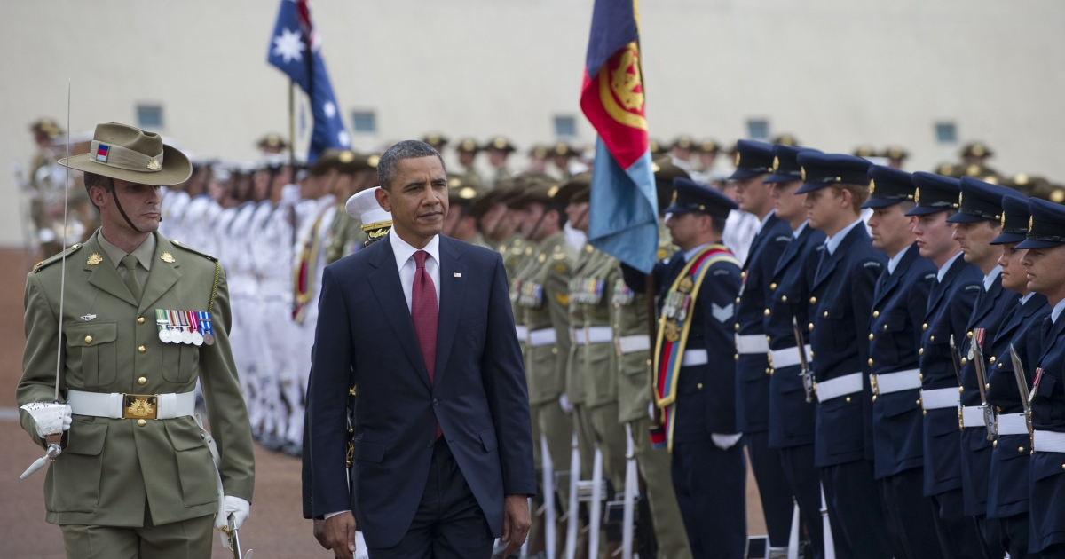 US President Barack Obama walks past an honor guard during an official arrival ceremony upon arrival at Parliament House in Canberra, Australia, on November 16, 2011.</p>