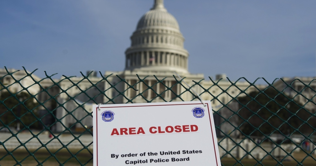 An area around the US Capitol is closed off as workers prepare for the US Presidential Inauguration ceremony in Washington, DC, on January 8, 2013. US President Barack Obama will be ceremonially sworn in for his second term during the public Inauguration event attended by hundreds of thousands of spectators on January 21, 2013.</p>