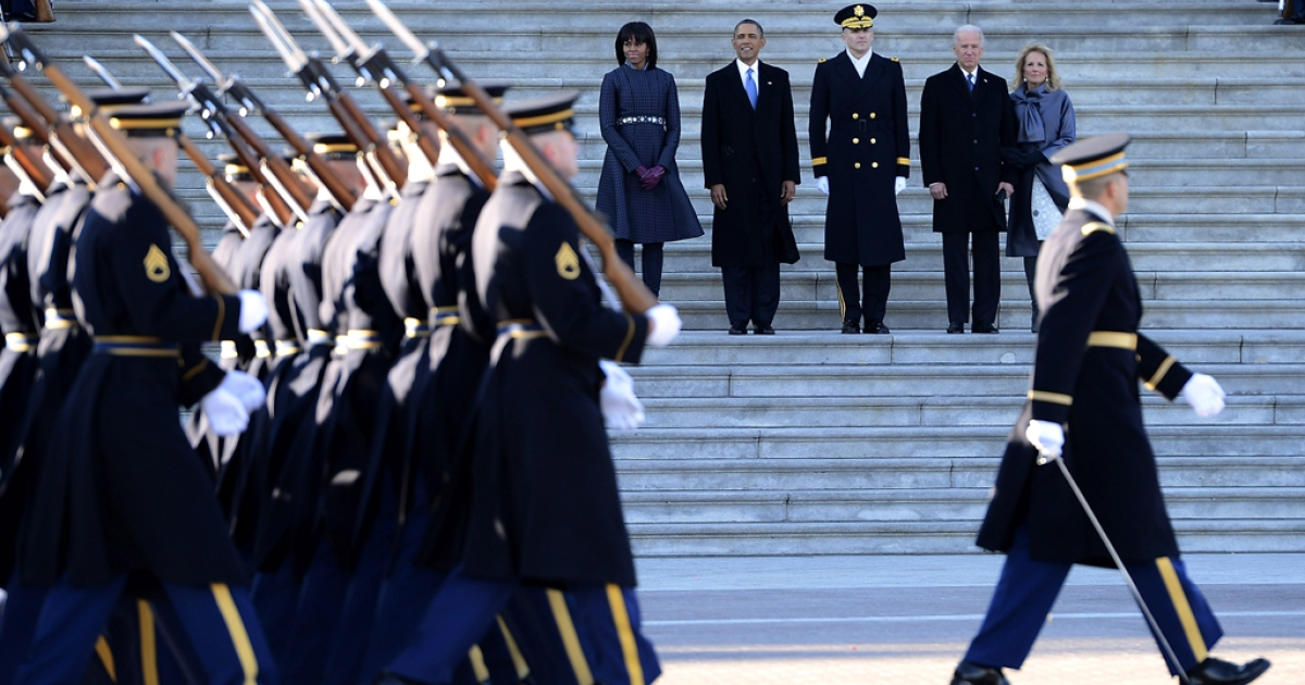 US President Barack Obama (2L), his wife Michelle Obama (L), Vice President Joe Biden (2R) and his wife Dr. Jill Biden (R) and U.S. Army Maj. Gen. Michael J. Linnington (C) watch during the Presidential review of the troops on the east side of the U.S. Capitol following Obama's Inaugural address and ceremonial swearing-in for a second term as the 44th President of the United States on January 21, 2013 in Washington, DC.</p>