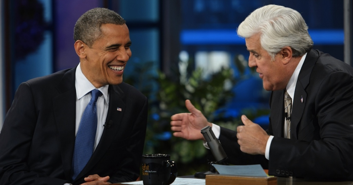 """US President Barack Obama chats with host Jay Leno during a break in the taping of """"The Tonight Show with Jay Leno"""" October 24, 2012 at NBC Studios in Burbank, California.</p>"""