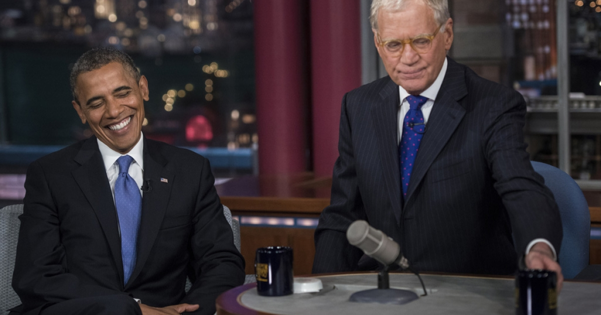 US President Barack Obama and David Letterman speak during a break in the taping of the