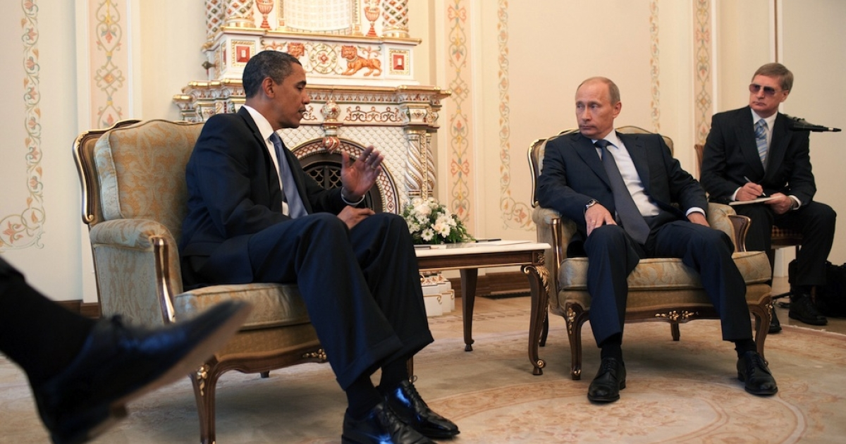 In this photo provided by The White House, US President Barack Obama (L) talks with Russian Prime Minister Vladimir Putin at his dacha on July 07, 2009 in Moscow, Russia.</p>