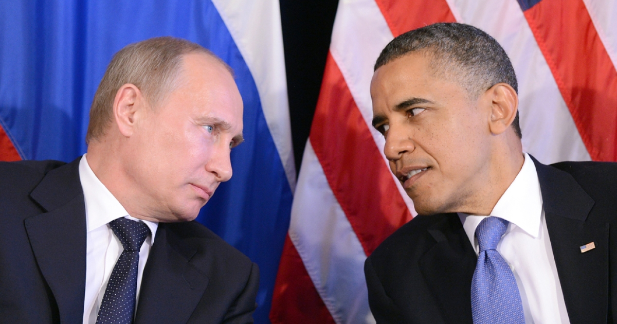 US President Barack Obama (R) listens to Russian President Vladimir Putin after their bilateral meeting in Los Cabos, Mexico on June 18, 2012 on the sidelines of the G20 summit. Obama and President Vladimir Putin met Monday, for the first time since the Russian leader's return to the presidency, for talks overshadowed by a row over Syria.</p>
