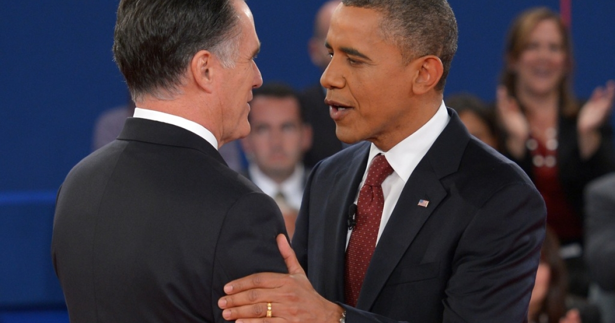 US President Barack Obama(R) greets Republican presidential candidate Mitt Romney October 16, 2012 as the candidates arrive on stage for the second presidential debate at the David Mack Center at Hofstra University in Hempstead, New York.</p>