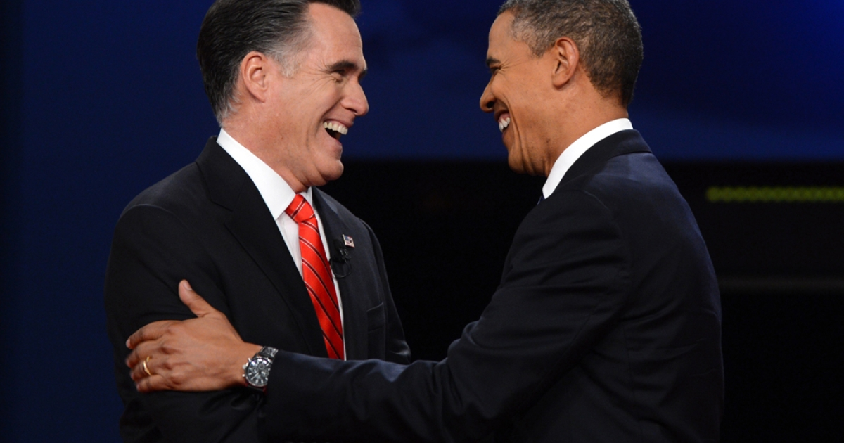 US President Barack Obama (R) and Republican Presidential candidate Mitt Romney (L) shake hands moments before the start of the first presidential debate at Magness Arena at the University of Denver in Denver, Colorado, October 3, 2012.</p>