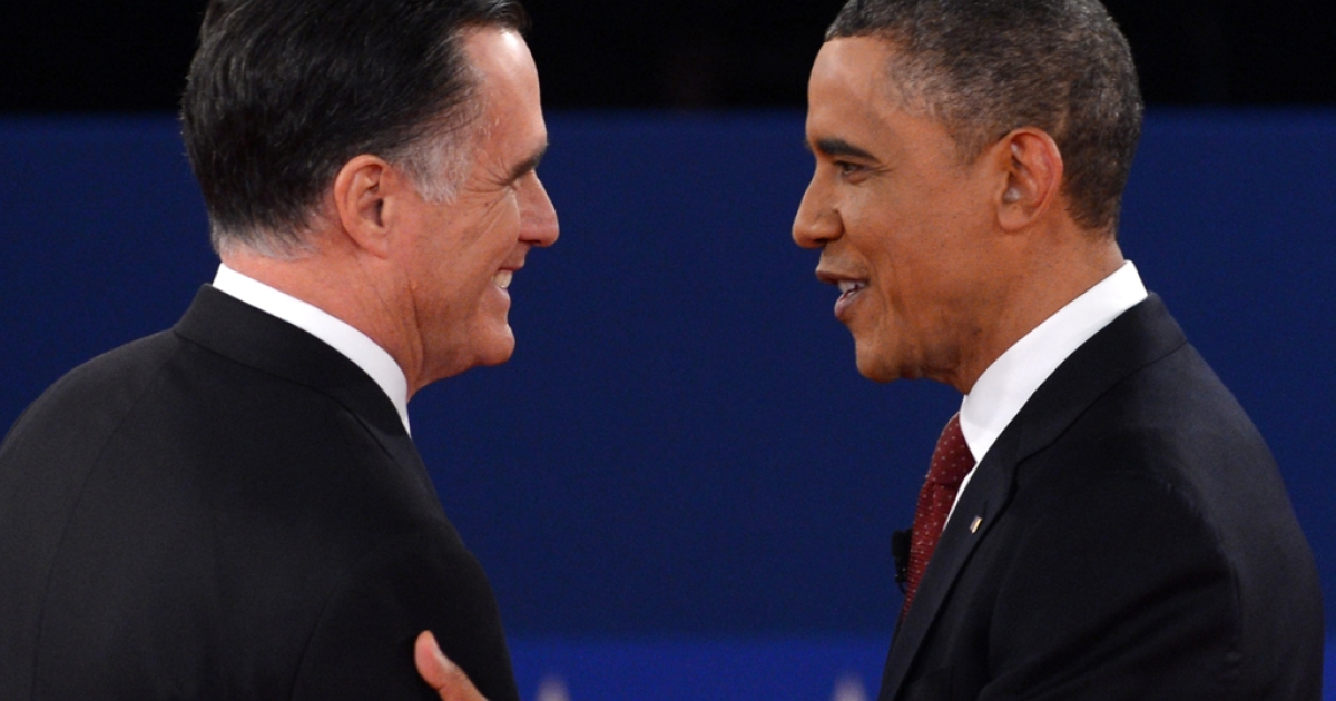 US President Barack Obama and Republican presidential candidate Mitt Romney arrive on stage for the second presidential debate, the only held in a town hall format, at the David Mack Center at Hofstra University in Hempstead, New York, October 16, 2012, moderated by CNN's Candy Crowley.</p>