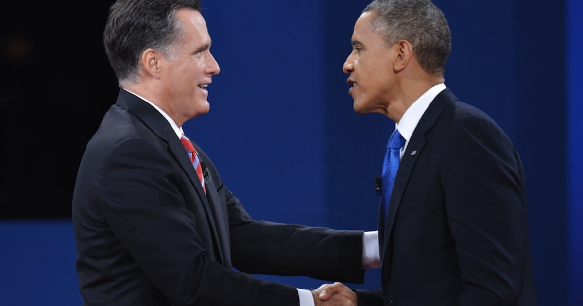 US President Barack Obama shakes hands with Republican presidential candidate Mitt Romney at the end of the third and final presidential debate October 22, 2012 at Lynn University in Boca Raton, Florida.</p>