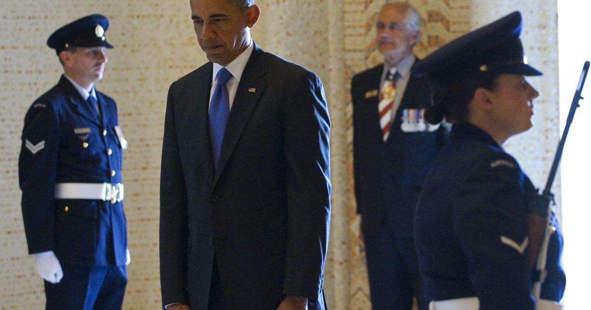US President Barack Obama pauses during a moment of silence during a wreath laying ceremony at the Australian War Memorial in Canberra on November 17, 2011.</p>