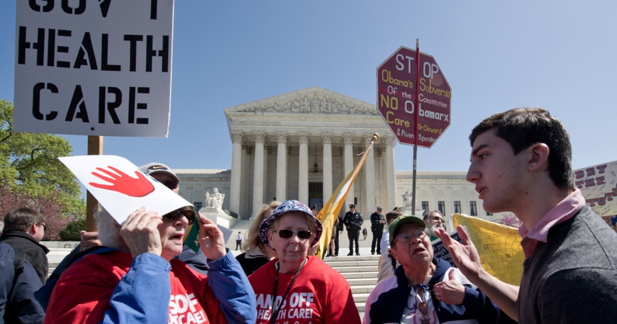 A supporter of President Barack Obama's health care reforms  argues with several elderly women who are against the reforms in front of the US Supreme Court in Washington, DC after the morning session March 27, 2012. The US Supreme Court Tuesday took up the most contentious part of President Barack Obama's landmark health care reform, hearing arguments on whether it is constitutional to require Americans to buy insurance coverage. The second day of an unprecedented three days of arguments into the Affordable Care Act, derided by opponents as