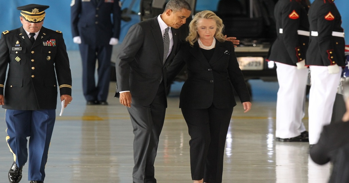 JOINT BASE ANDREWS, MD - SEPTEMBER 14:  U.S. President Barack Obama and U.S. Secretary of State Hillary Clinton walk away from the podium during the Transfer of Remains Ceremony for the return of Ambassador Christopher Stevens and three other Libyan embassy employees at Joint Base Andrews September 14. 2012 in Joint Base Andrews, Maryland. Stevens and the three other embassy employees were killed when the consulate in Libya was attacked September 11.   (Photo by Molly Riley-Pool/Getty Images)</p>