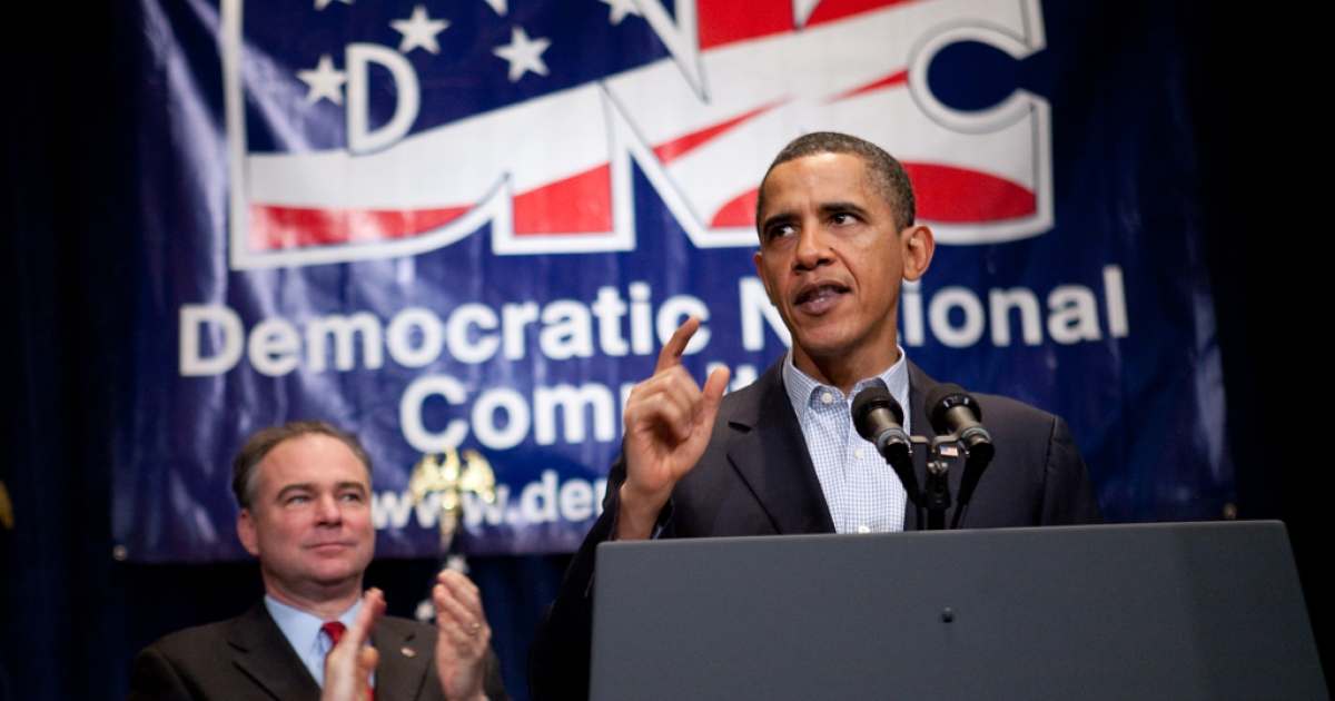 President Barack Obama receives applause from Democratic National Committee chairman Tim Kaine (L) as he delivers remarks at the DNC winter meeting on Feb. 6, 2010, in Washington, DC.</p>