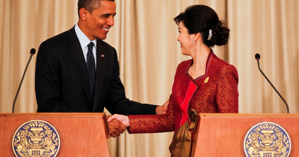 US President Barack Obama shakes hands with Thai Prime Minister Yingluck Shinawatra at a joint press conference, in Government House on November 18, 2012 in Bangkok, Thailand. The US President spoke of Thailand's support of democracy in Myanmar. Obama will become the first serving US President to visit Myanmar during his four-day tour of Southeast Asia that will also include visits to Thailand and Cambodia.</p>