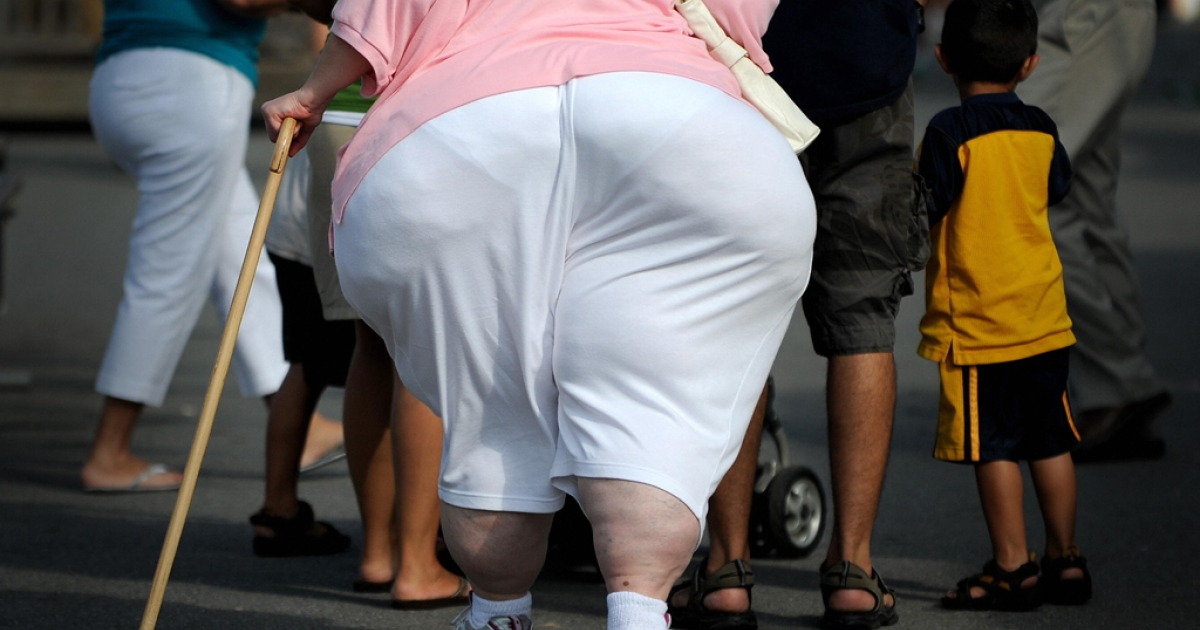 An overweight woman walks at the 61st Montgomery County Agricultural Fair on August 19, 2009 in Gaithersburg, Maryland.</p>