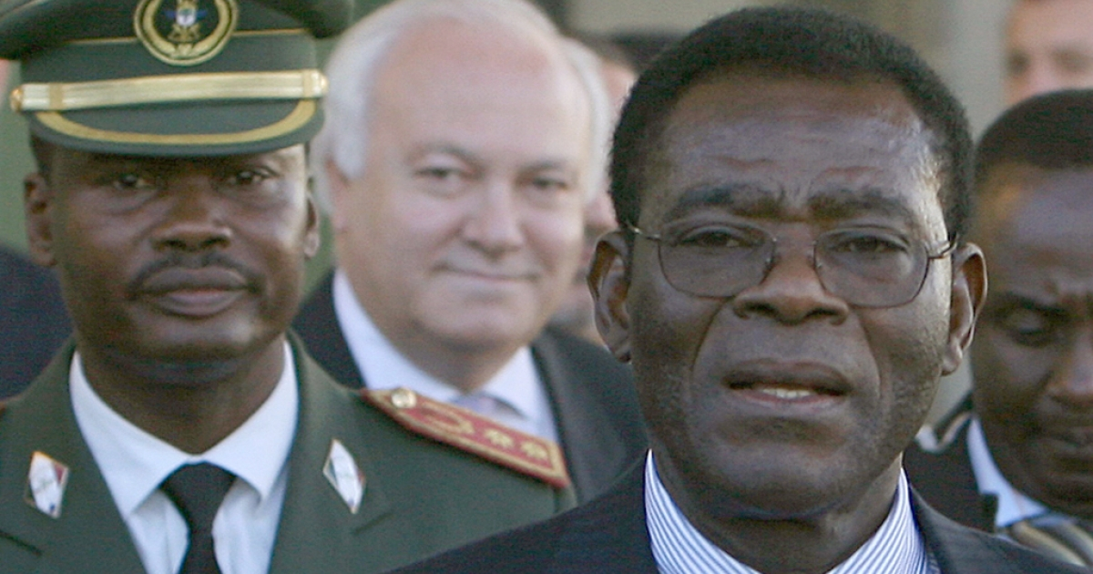 Teodorin Obiang's father, Equatorial Guinea President Teodoro Obiang, at right, is welcomed by Spanish Foreign Minister Miguel Angel Moratinos, center, on arrival in Madrid in November, 2006.</p>