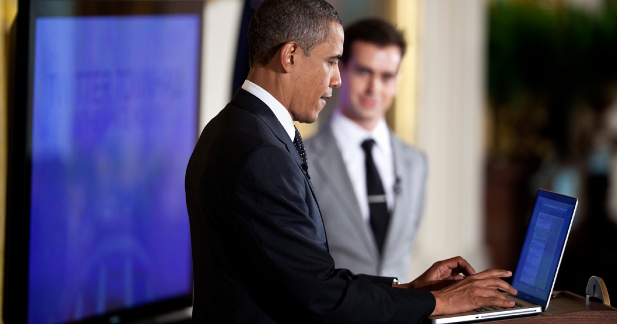 U.S. President Barack Obama posts a Tweet during an online Twitter town hall meeting from the East Room of the White House.</p>