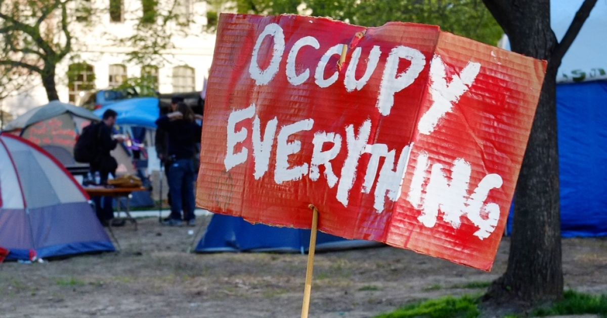 A sign reading 'Occupy everything' is seen at an Occupy DC protester's camp at McPherson Square park in Washington, DC, on April 5, 2012.</p>