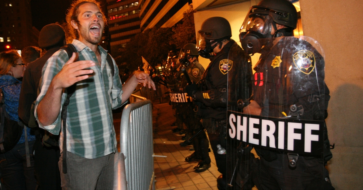 An Occupy Oakland protester shouts in front of police officers during a protest against the city's move to take down the Occupy Oakland camp site on Oct. 25, 2011.</p>