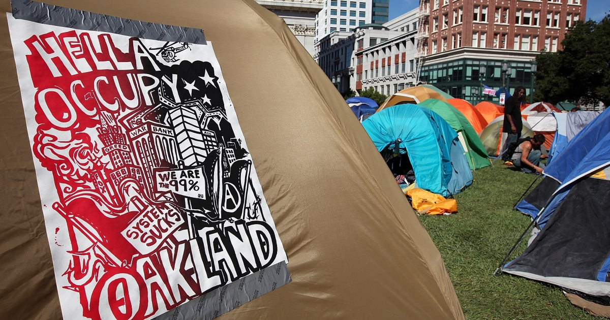 This sign was posted on the side of a tent at the Occupy Oakland protest outside of Oakland City Hall on October 13. More than 200 police officers ousted the protesters of the Occupy Oakland movement early Tuesday morning.</p>