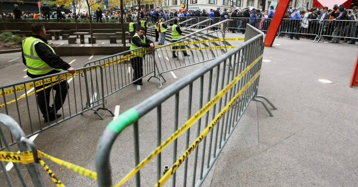 Occupy Wall Street activists protest outside Zuccotti Park after police removed the protesters early in the morning from Zuccotti Park on November 15, 2011 in New York City.</p>