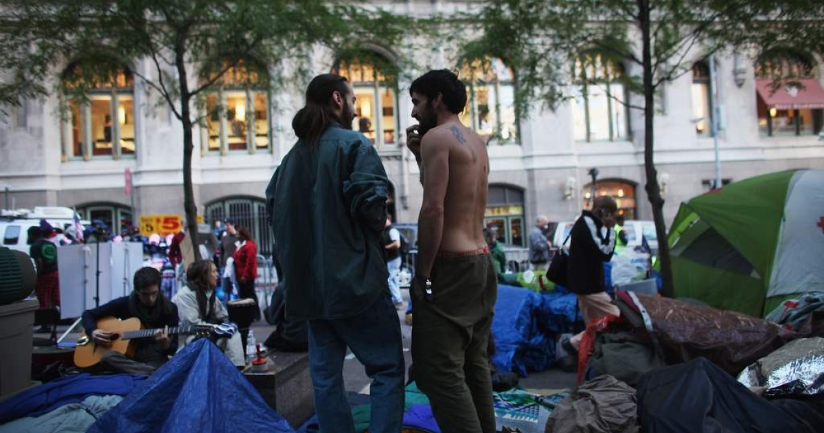 Men stand in Zuccotti Park in the Financial District where 'Occupy Wall Street' protesters are living on October 17, 2011 in New York City.</p>