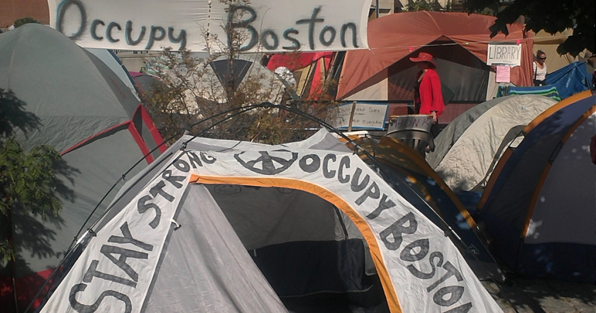 A banner hangs above Occupy Boston's camp in Dewey Square, located in Boston's financial district.</p>
