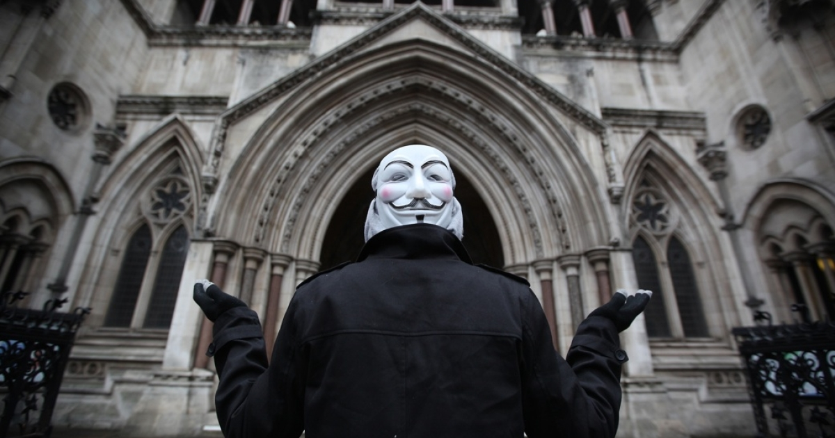 A supporter of The Occupy London protest group stands outside The High Court on January 18, 2012 in London, England.</p>