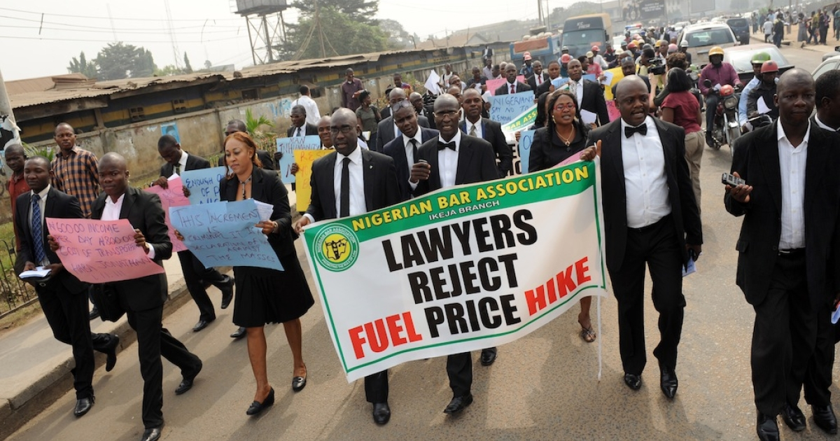 Occupy Nigeria has arrived in Ibadan. Here, lawyers carry a banner and placards as they march in Lagos streets to protest against soaring fuel prices on January 5, 2012. Nigeria has seen increasingly volatile demonstrations since the government announced the end of fuel subsidies, causing petrol prices to instantly double.</p>