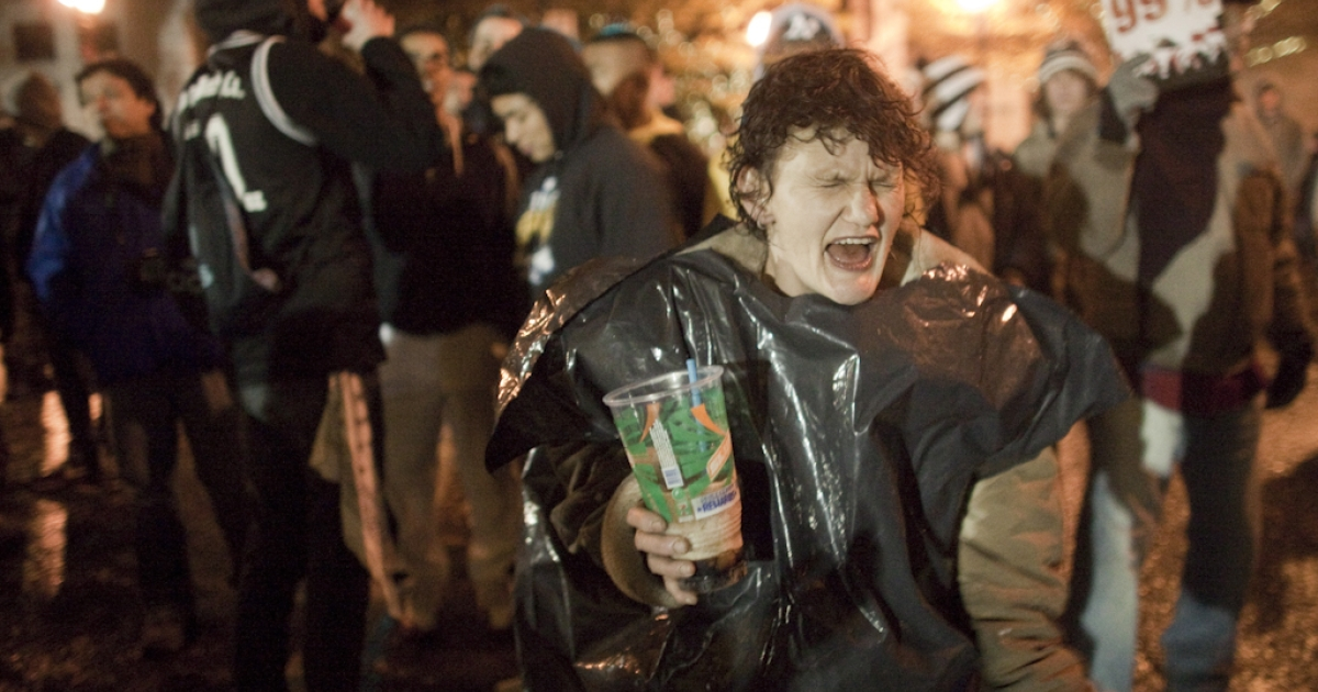 A woman drinks and dances at the Occupy Portland movement, November 13, 2011 in Portland, Oregon. In spite of an eviction notice for early Sunday morning, Portland police delayed closing two downtown parks early today as thousands of people converged to support the Occupy Portland movement.</p>