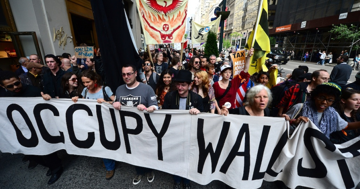 Occupy Wall Street participants march down Fifth Avenue as part of May Day events in New York City on May 1, 2012. The Occupy movement shook the United States last year, spawning similar demonstrations and strikes worldwide against social inequality.</p>