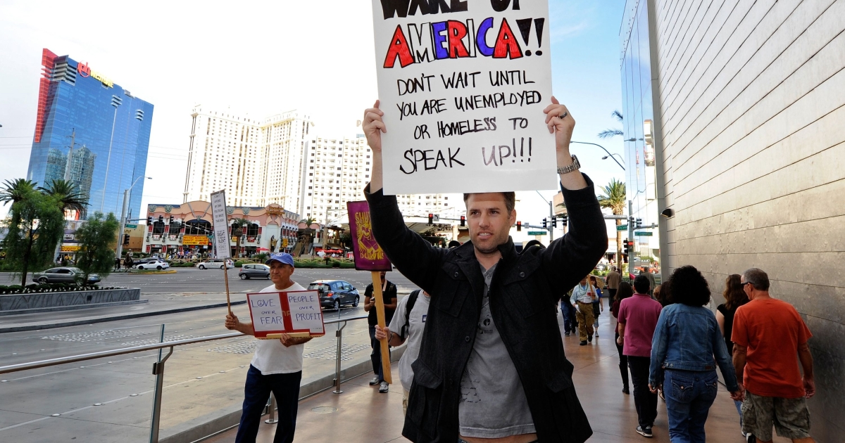 Protesters with the Occupy Las Vegas movement march on the Las Vegas Strip October 6, 2011 in Las Vegas, Nevada. The protest is one of many around the country held in solidarity with the Occupy Wall Street protests in New York City.</p>