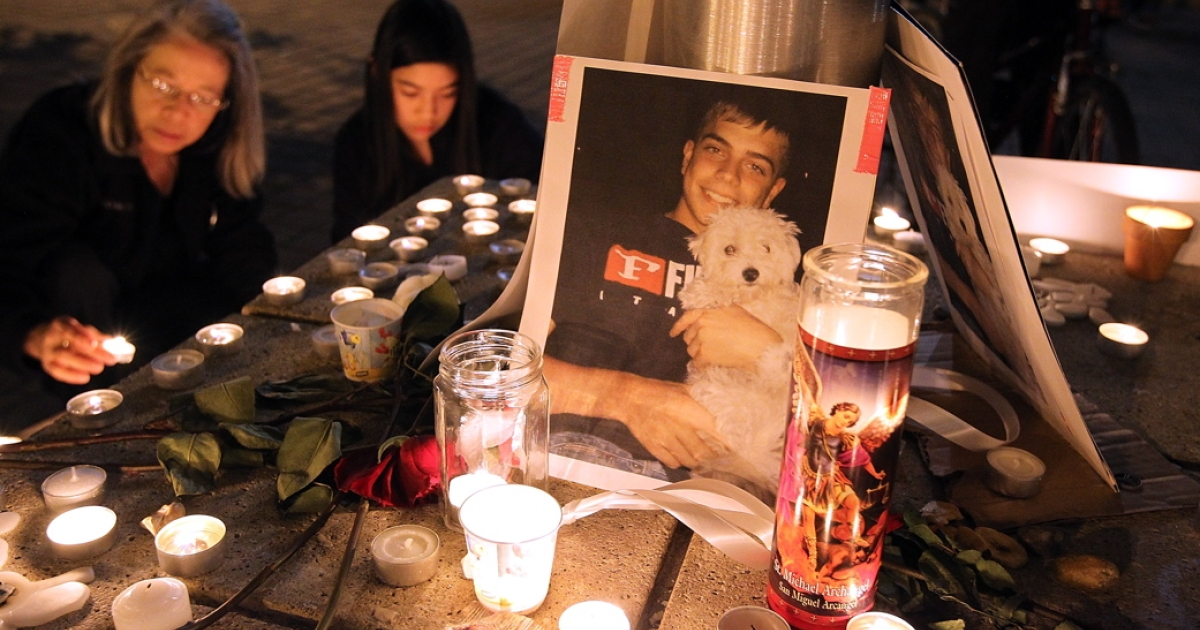A photograph sits on a memorial for Scott Olsen, an Iraq veteran who was severely injured during a standoff between Occupy Oakland and Oakland police, near the Occupy Oakland encampment on October 27, 2011 in Oakland, California.</p>
