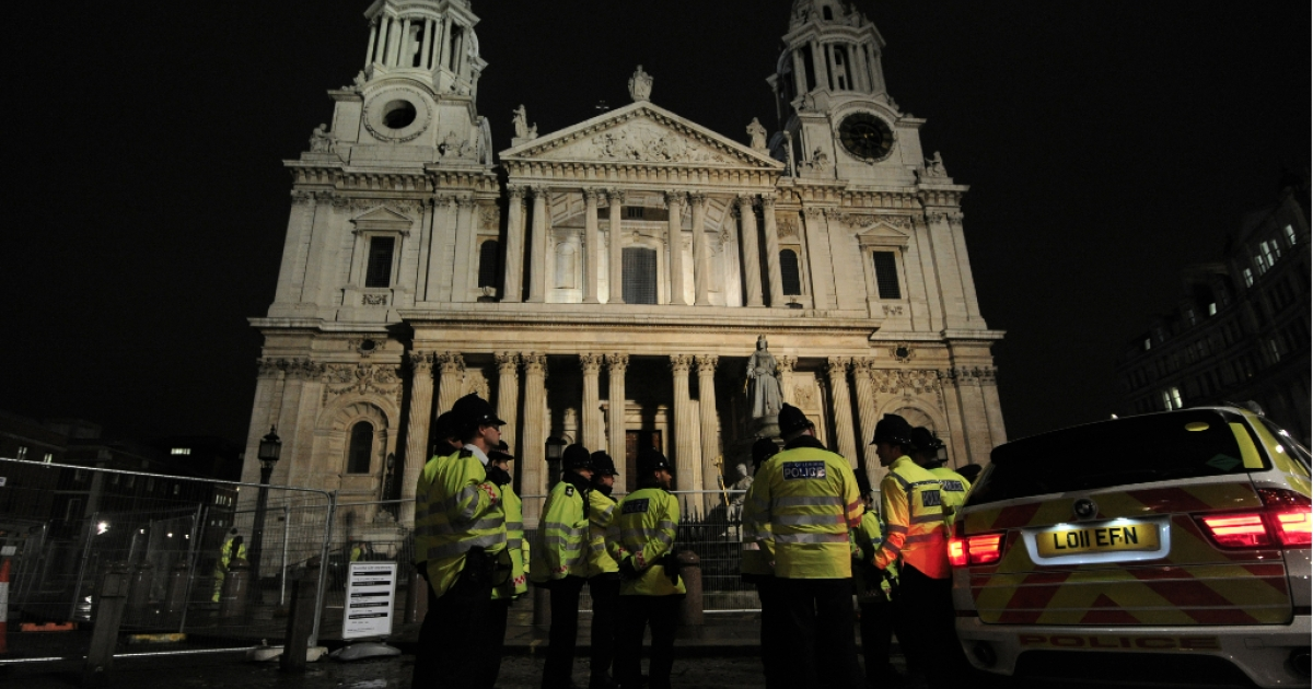 Police guard London's Saint Paul's Cathedral today after police and bailiffs cleared protesters from the Occupy camp outside the 300-year-old church.</p>