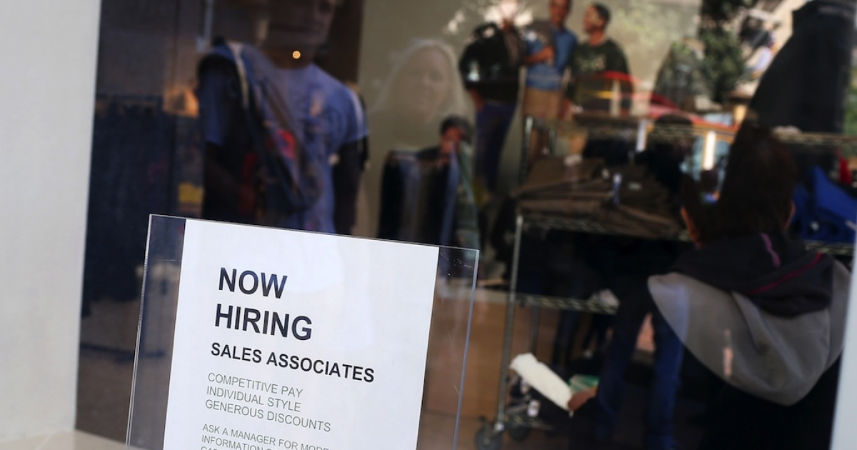 A 'now hiring' sign is posted in the window of a GAP store on Sept. 27, 2012 in San Francisco, California. The Labor Department released October unemployment data on Nov. 2 that showed 171,000 jobs were added to the US economy in October, while the unemployment rate rose slightly to 7.9 percent as more workers searched for employment.</p>