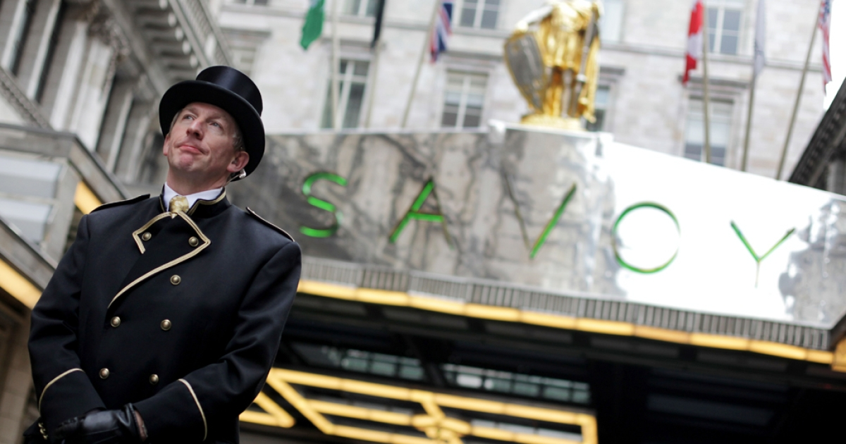 A doorman stands outside the famous Savoy hotel in London, England. Bev Oda, a Canadian politician in charge of international co-operation, is in hot water for billing taxpayers $1,400 to stay there last June.</p>