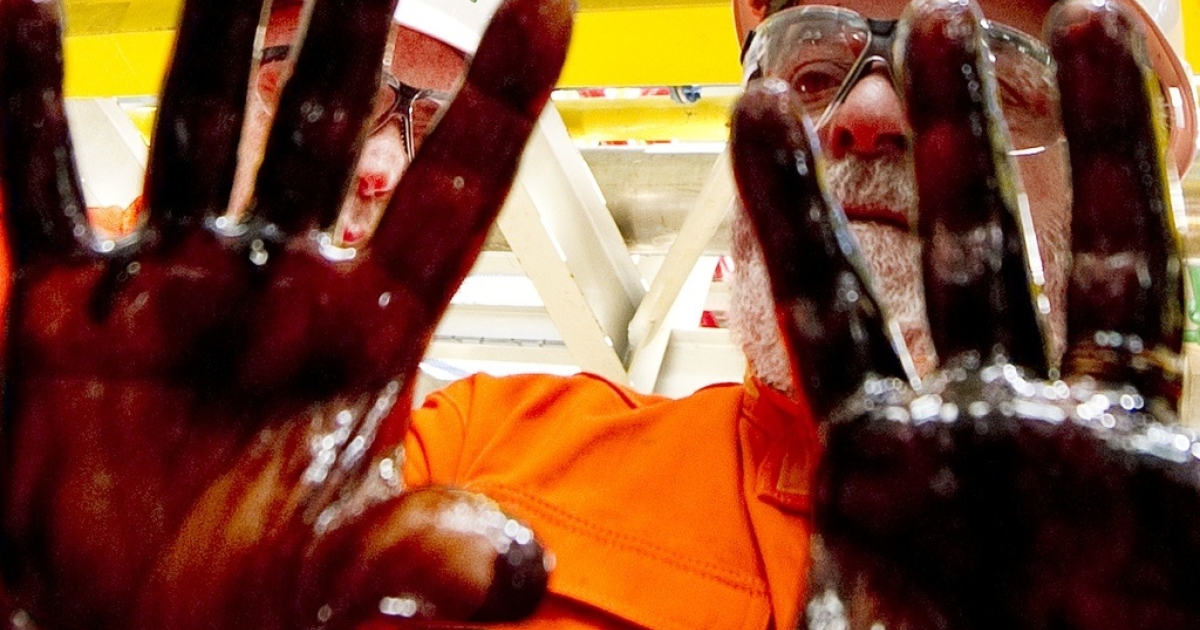 Then-Brazilian President Luiz Inacio Lula da Silva shows his hands dirty with the first oil extracted from the Tupi oilfield, on Oct. 28, 2010.</p>