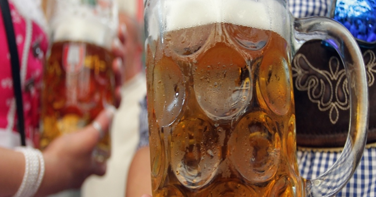 Mugs of beer, like these served at the Oktoberfest beer festival in Munich, Germany, this year, are a new feature of Oktoberfest in Cullman, Alabama.</p>