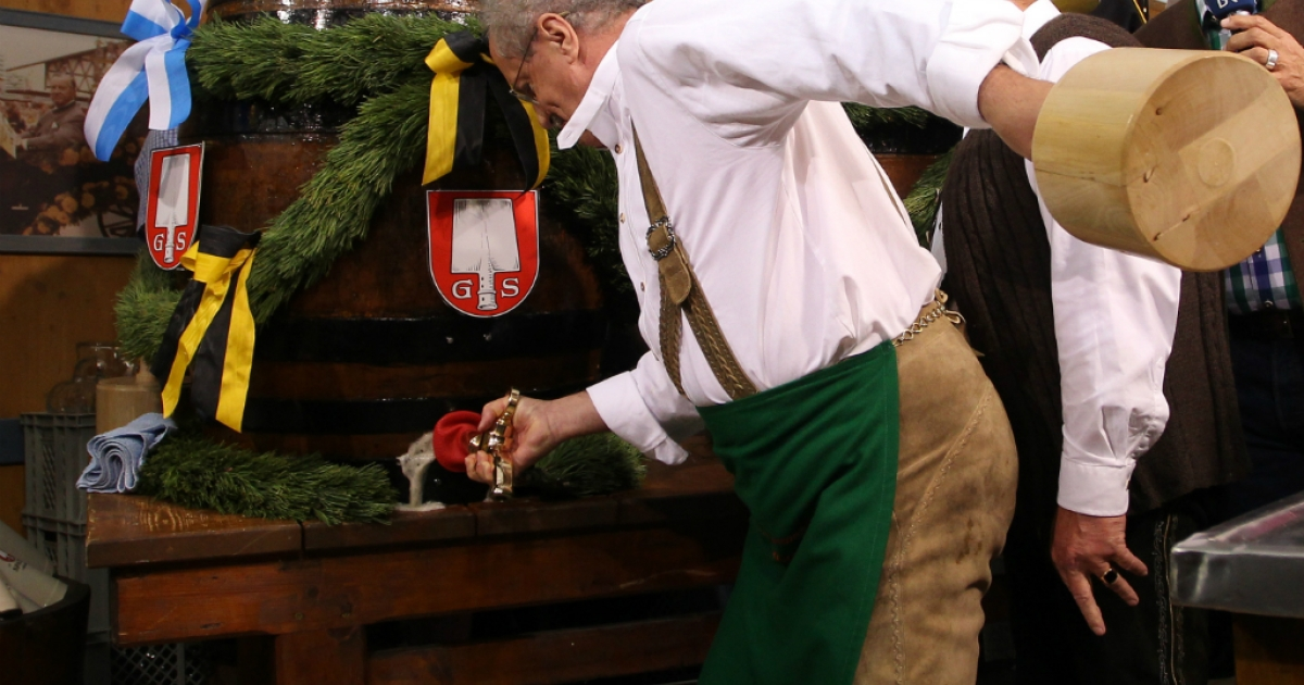 Munich mayor Christian Ude taps the first barrel of beer with the traditional 'O'zapft is!' (It's tapped!) to start the Oktoberfest 2012 beer festival at Theresienwieseat on September 22, 2012 in Munich, Germany.</p>