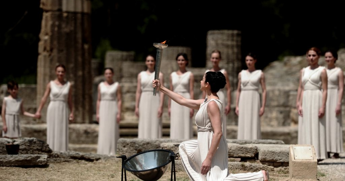 Actress Ino Menegaki, acting as high priestess holds the torch carrying the Olympic Flame on May 10, 2012 during the lighting ceremony in ancient Olympia at the sanctuary where the Olympic Games were born in 776 B.C.</p>