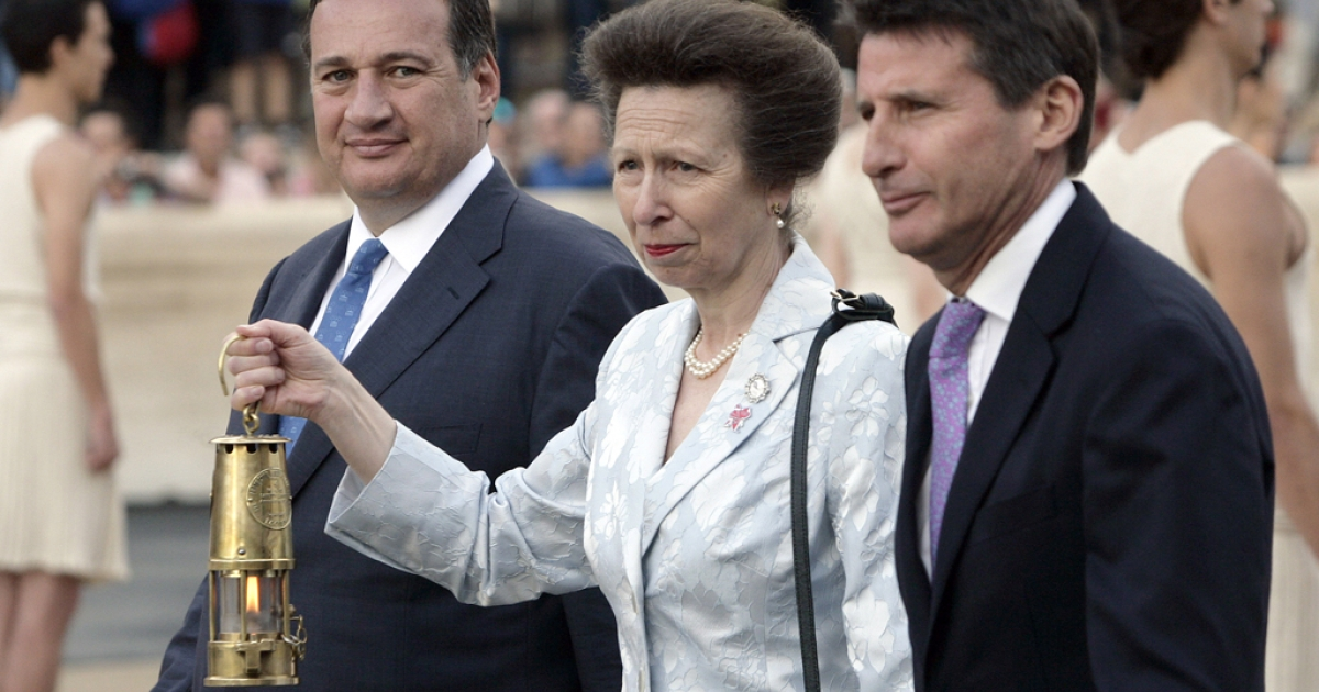 Princess Anne, Princess Royal (C) holds a carrier containing the Olympic flame (C) alongside Spiros Kapralos (L),  President of Greek IOC, at the Panathinaiko stadium during the Olympic Torch Handover Ceremony, on May 17, 2012 in Athens, Greece.</p>