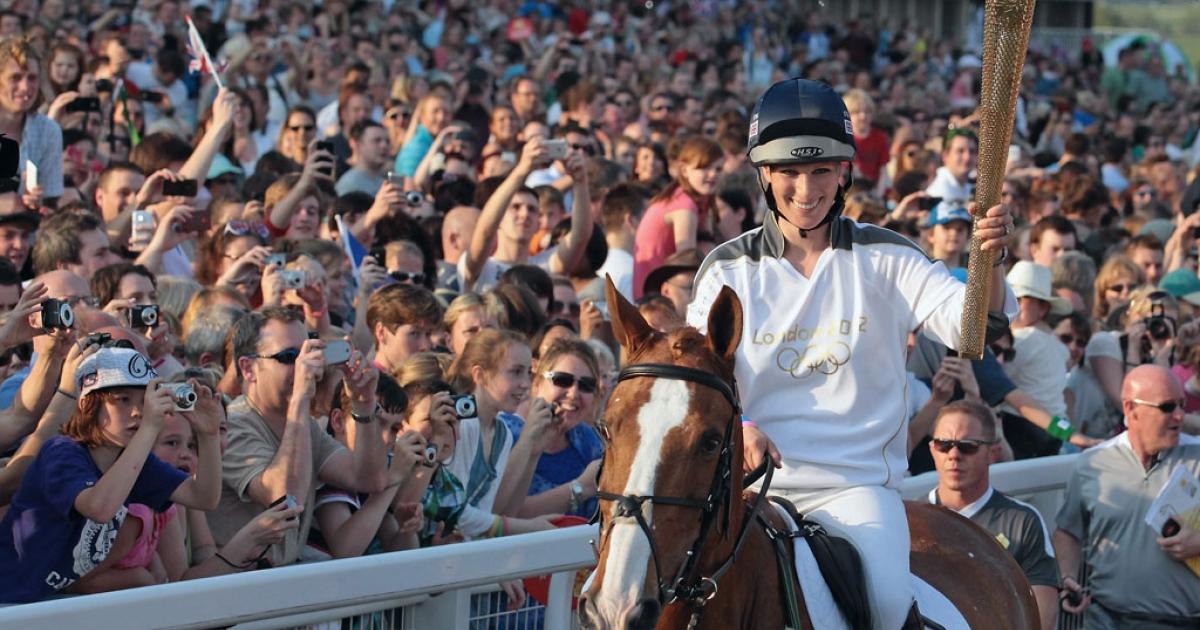 Olympic torchbearer Zara Phillips arrives on Toytown at Cheltenham racecourse on May 23, 2012, in Cheltenham, England.</p>