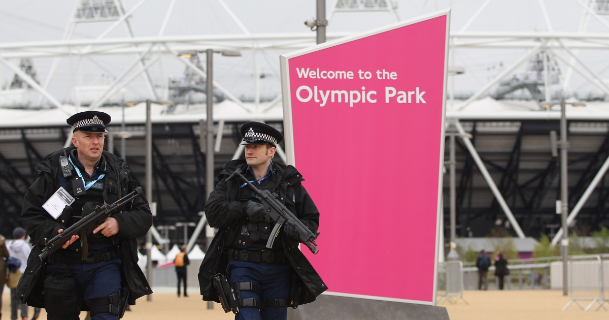 Armed police officers patrol the Olympic Park</p>