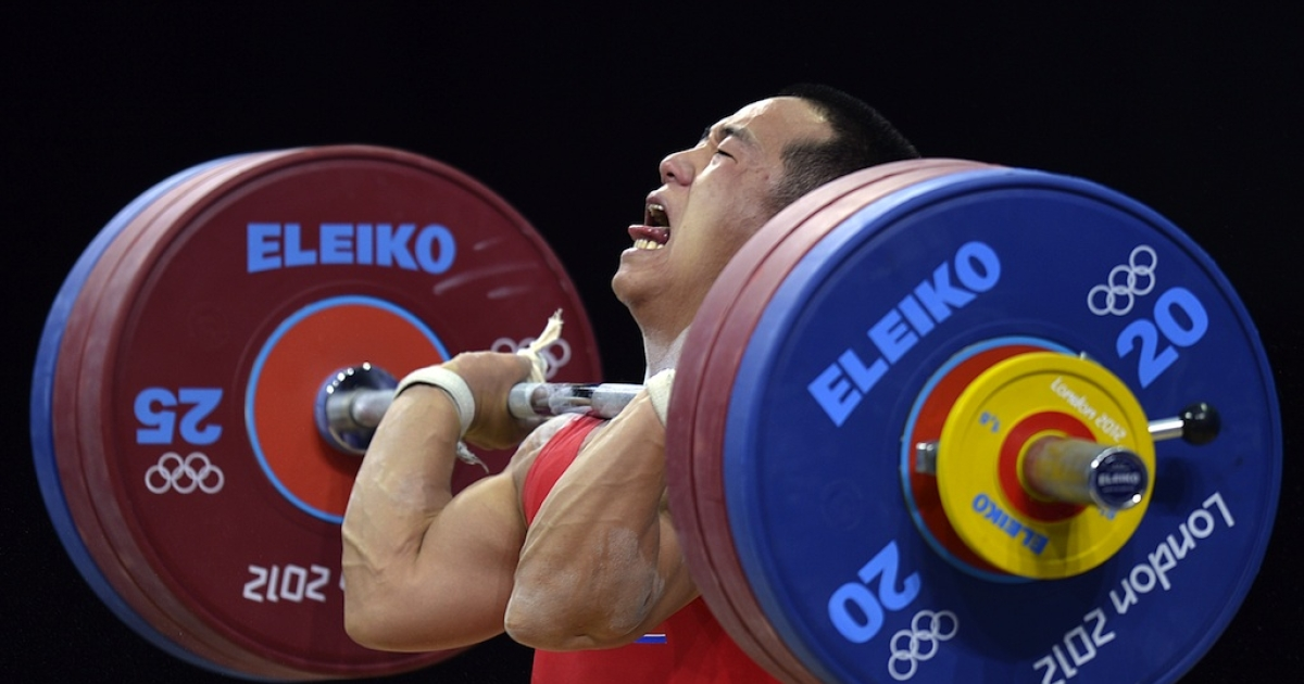 North Korean weightlifter Om Yun Choi in action at the London Olympics.</p>