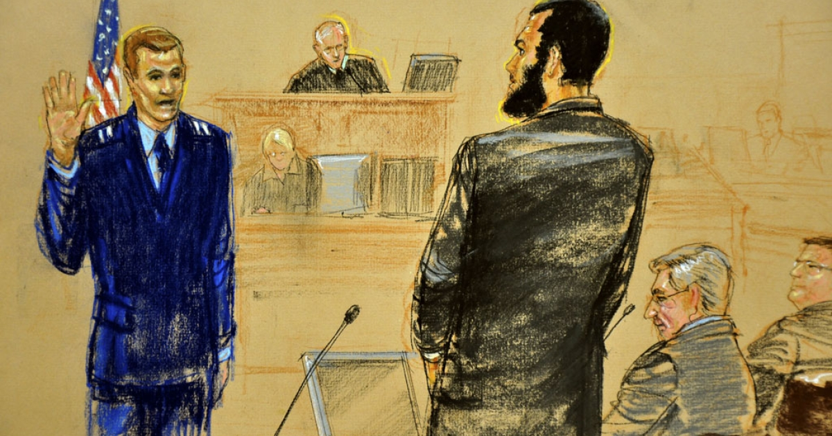 In this Pentagon-approved photograph of a sketch by Janet Hamlin, Omar Khadr addresses USAF Capt. Michael Grant on Oct. 25, 2010, in Guantanamo Bay, Cuba. Khadr filed a request on April 18, 2012, to serve his sentence in a Canadian jail.</p>